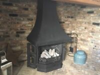 Gas fire log effect with hood