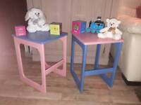 Two tables, pink and blue.