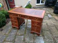 Red leather top writing desk