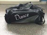 Black and silver dance bag.