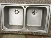 Twin stainless steel sinks and taps