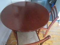 Dinning table and 4 chairs. Good condition.