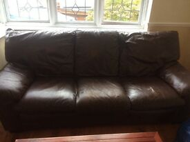 3 seater brown leather settee, 2 of the seats are well worn 1 with a rip but really comfortable