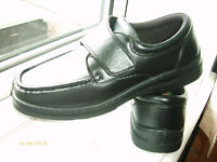 Lightweight, flexible shoes with velcro fastening. (AS NEW)