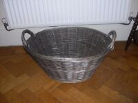 A large wicker laundry basket.