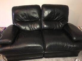 2 x Black leather reclining sofas