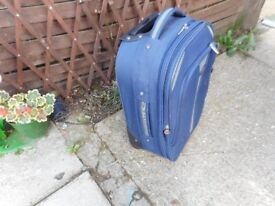 small blue azure pull along suit case