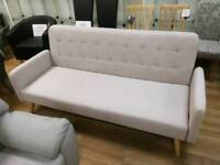 Cream fabric sofabed easy to use with wooden legs