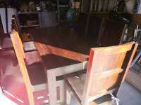 Wooden dining table with 8 chairs in good condition