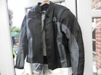 Ladies two tone leather motorcycle jacket. Tailored fit. Size 12/14