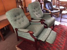 2 x manual reclining arm chairs. Green material. Button backs with padded arms. Very comfortable
