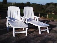 2 white plastic garden sun loungers