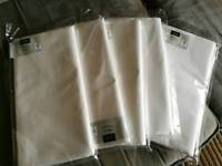 Five linen-feel white paper tablecloths