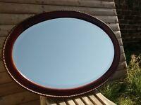 Large oval mirror in oak frame