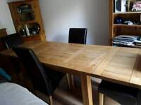 Extendable solid oak dining table (seats 6-10 people)