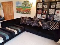 Large comfortable corner sofa with matching coffee table