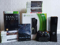 As New with all packaging a XBOX 360 Slim 250GB, including 19 games and controller keypad