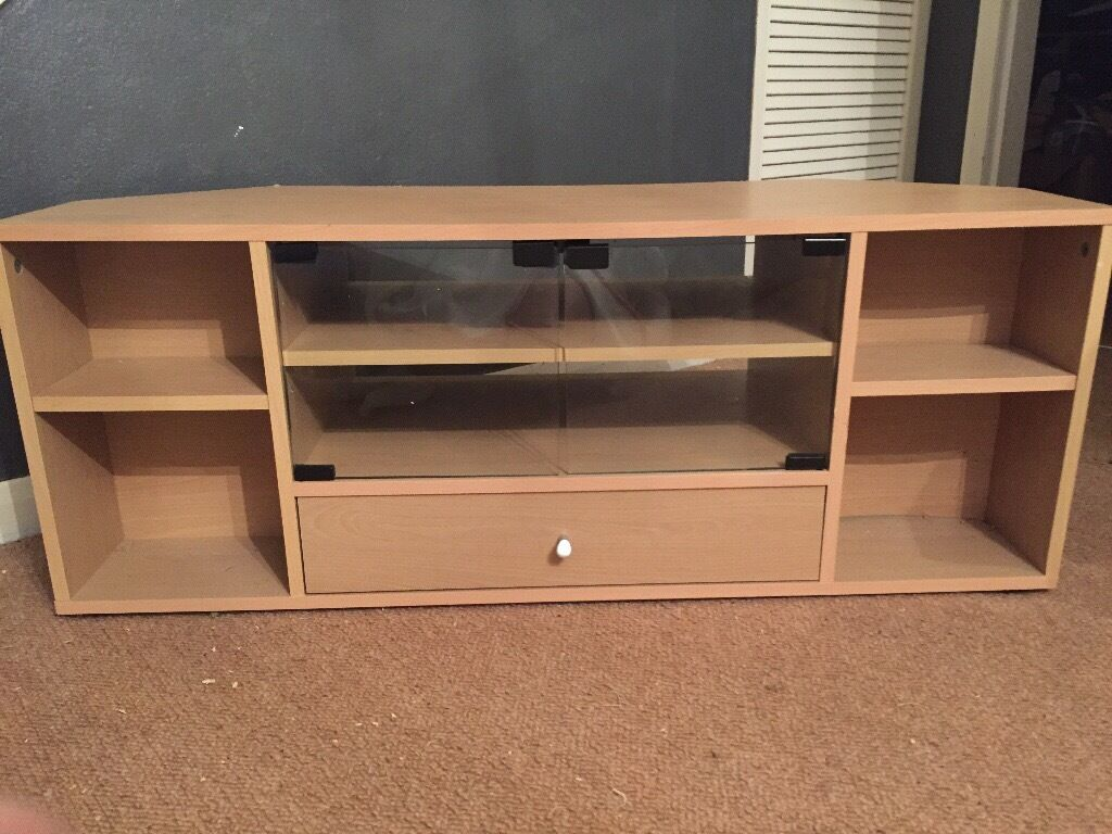 Wooden TV stand with glass doors. Excellent condition!