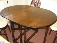 Dark oak folding table and 4 chairs
