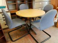 Round meeting table with 4 blue fabric chairs