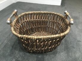 Wicker basket with silver coloured handles, makes great log basket