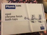 Pair of new chrome bath taps