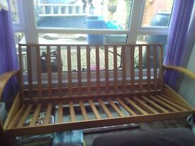 futon wooden folds out to double bed (no mattress)