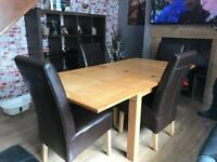 Dining table and chairs (could drop off if local)