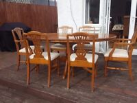 Good quality solid wood dining table and 6 chairs