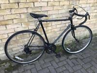 Black racing road bike zxczzcvv