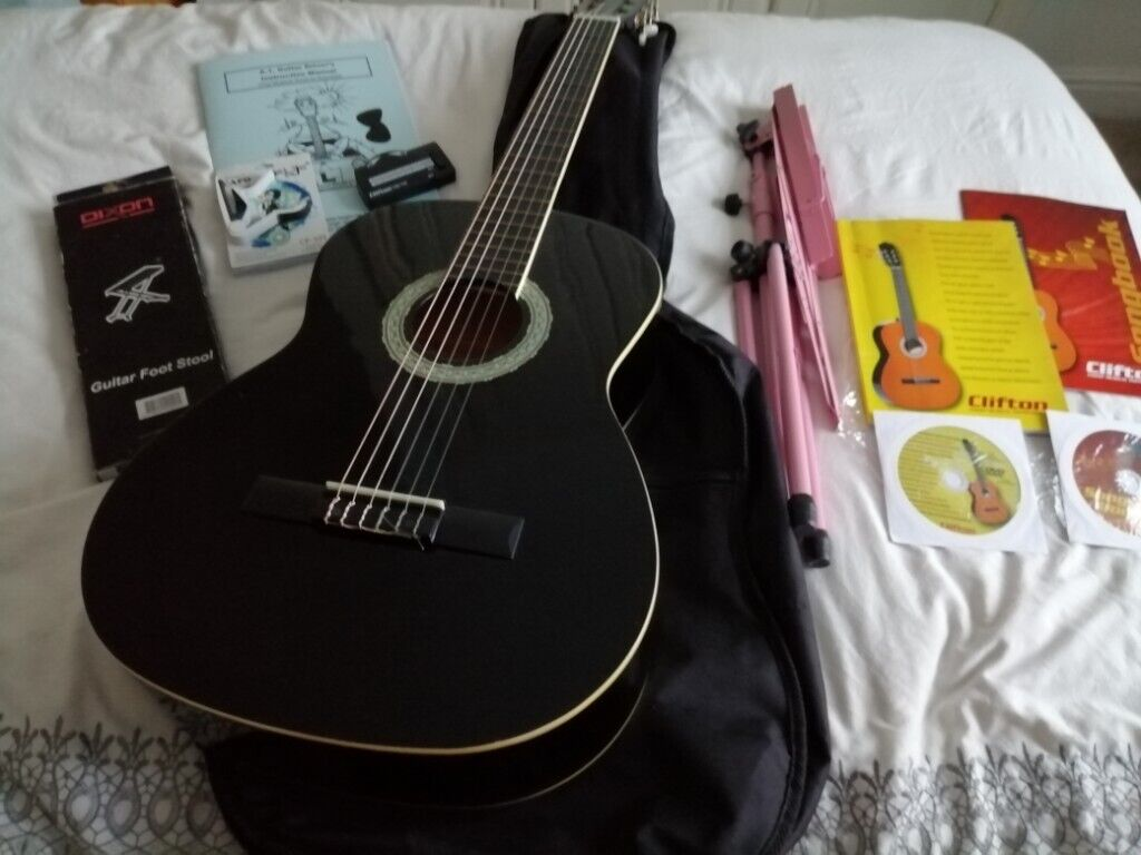Full size concert guitar with several extras, used twice    in Ripon, North  Yorkshire   Gumtree