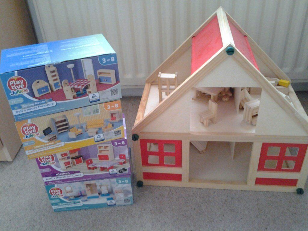 Dolls wooden house and 3 boxes of furniture never opened....from pet and smoke free home