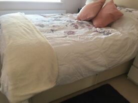 King size divan bed with two drawers and cream padded headboard. Good condition.