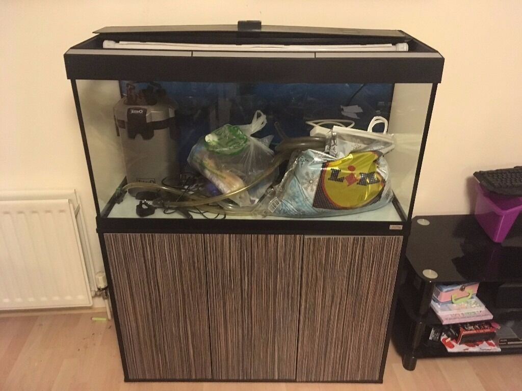 200L Fluval Tankin AberdeenGumtree - I have for sale my 200L Fluval fish tank comes with stand, external filter, heater, gravel, air pump, LED strip light, large net, gravel cleaner, and various bits and pieces i also have a couple 25L drums i used for water changes i will throw in as...