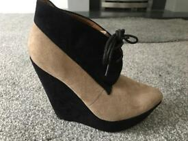 beige and black wedge angle boots size 5