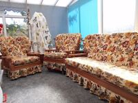 Conservatory sofa and two chairs,floral cushions and wooden frame