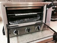 Oven with panini and grill function. Meals ready in minutes.