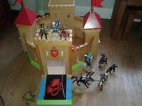 wooden elc castle and figures.