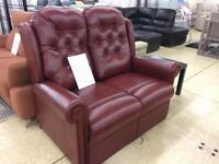 Sitting pretty 2 seater burgundy leather sofa