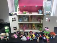 Beautiful Wooden Dolls House with furniture and people