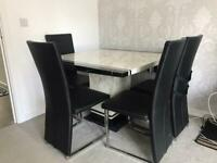 White and black Marble dining table with 4 black leather chairs