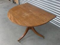 Small solid wood table on wheels