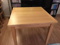Ikea expandable dining table for sale.