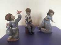 NAO by Lladro porcelain figurines, set of 3 for sale