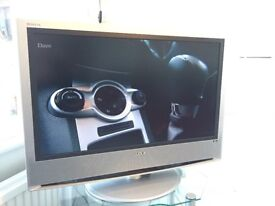 Sony Bravia 32 inch TV and glass tv cabinet on casters £35 January pick up.