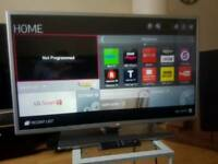 LG 32 INCH SMART FULL HD 1080P LED TV IN BOX WITH REMOTE AND STAND NOT SONY SAMSUNG PANASONIC
