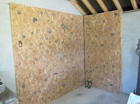 Climbing wall with real stone climbing holds