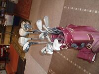 Set of Powerbar Golf Clubs with bag and practice balls