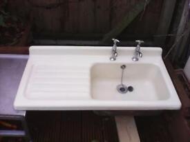 vintage farmhouse kitchen sink. cast iron with cream porcelain finish