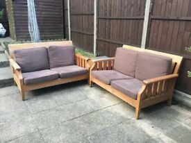 2 Teak Sofas And A Side Table